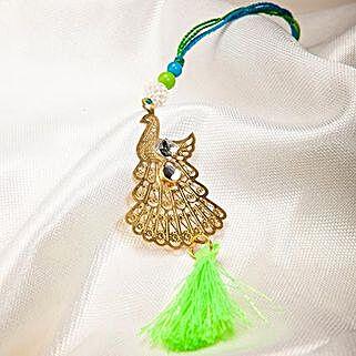 Attractive Metallic Peacock Lumba Rakhi: Rakhi Gifts to Bhutan