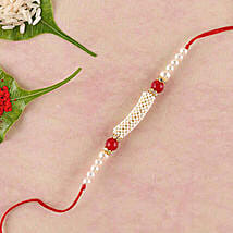 Gorgeous White And Red Beads Rakhi: Rakhi Delivery in China