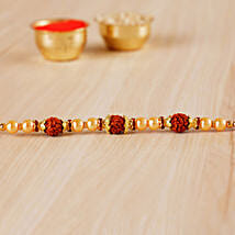 Golden Red Beaded Rudraksh Rakhi: Rakhi Delivery in Croatia