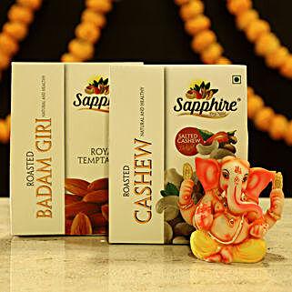Ganesha Idol And Dry Fruits
