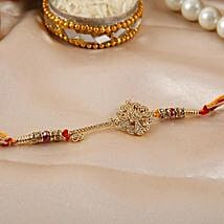 Key Shaped American Diamond Rakhi: Send Rakhi to Jordan