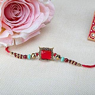 Square Pink Rakhi: Rakhi Gifts to Jordan