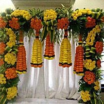 Orange and Yellow Floral Bottle Shape Decoration: Flowers for Janmashtami