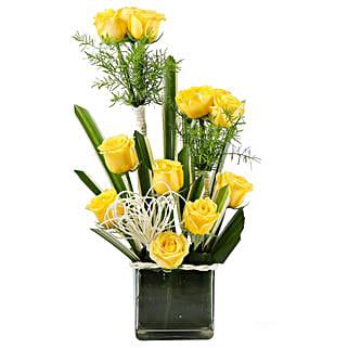 Yellow Paradise- 12 Yellow Roses in Glass Vase: Send Anniversary Gifts for Bhaiya Bhabhi