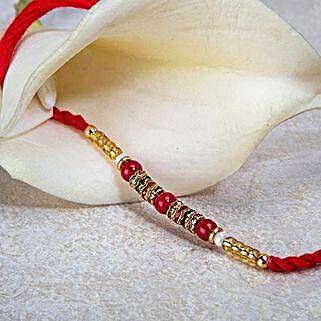 Red And Golden Bead Rakhi: Send Rakhi to Turkey