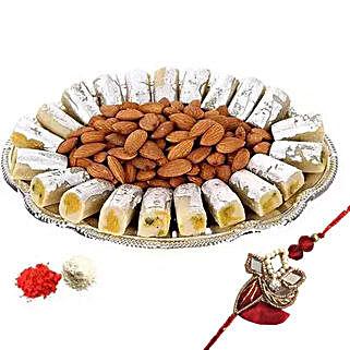 Rakhi with Kaju Roll n Almonds: Rakhi With Sweets to UAE