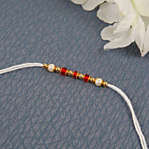 White Traditional Diamon Rakhi: Send Rakhi for Brother in Uk