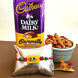 Cadbury Caramello Rakhi Combo: Rakhi with Dryfruits to USA